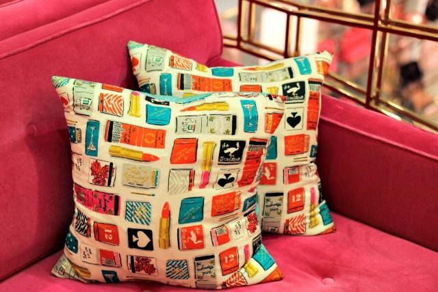 Pillows covered in whimsical illustrations at Kate Spade New York