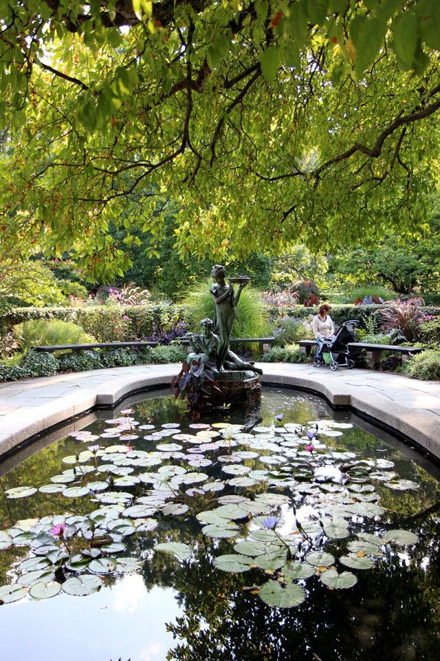 Francis Hodgson Burnett memorial statue and pond