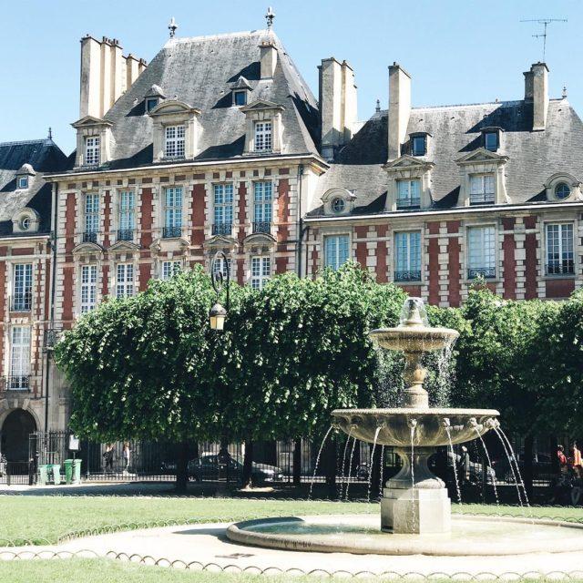 Sunny day at Place des Vosges  paris