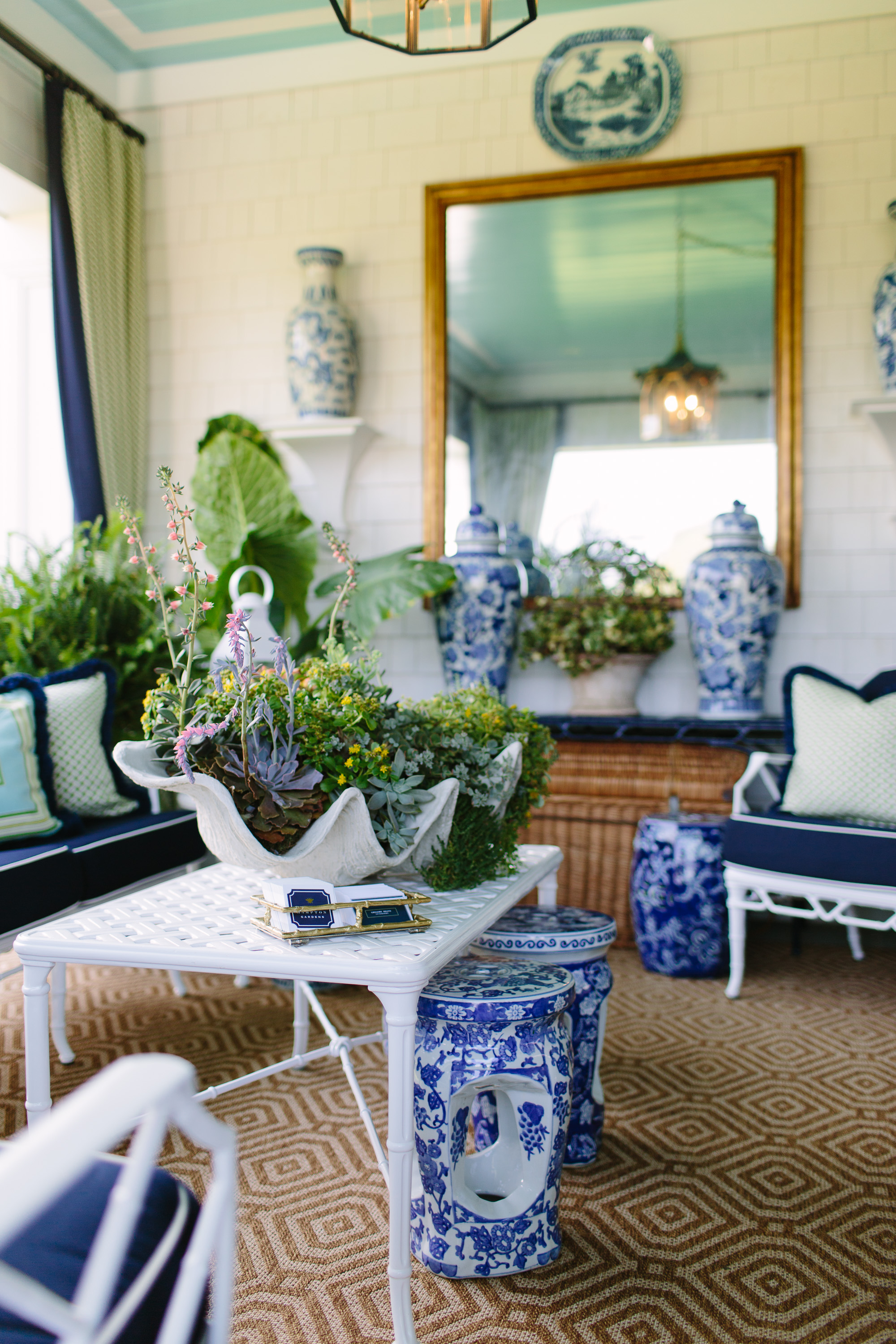 The covered porch designed by Gregory Shano at the 2017 Hampton Designer Showhouse