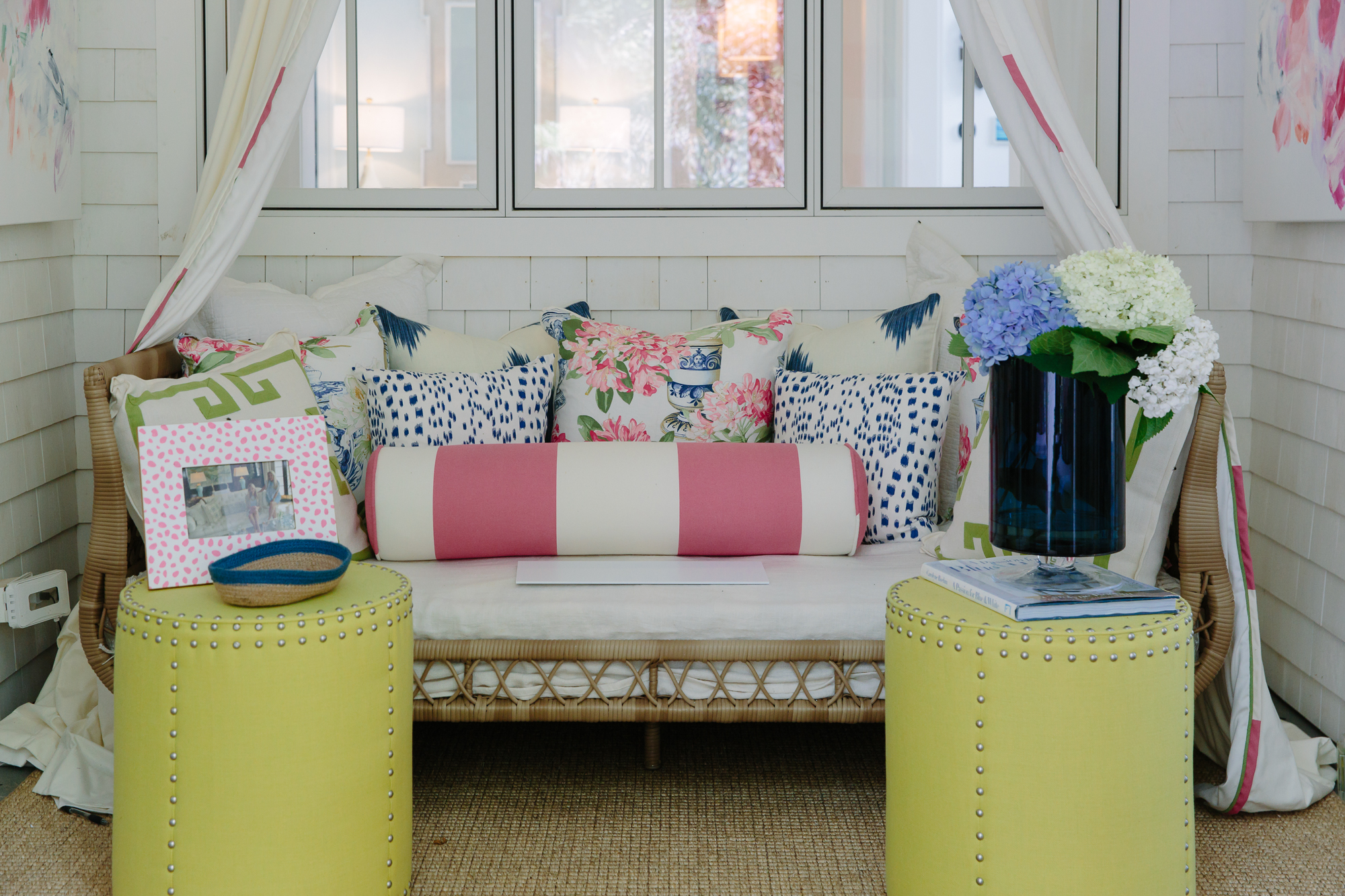 Les Touches and Cowtan and Tout pillows on Serena and Lily rattan daybed
