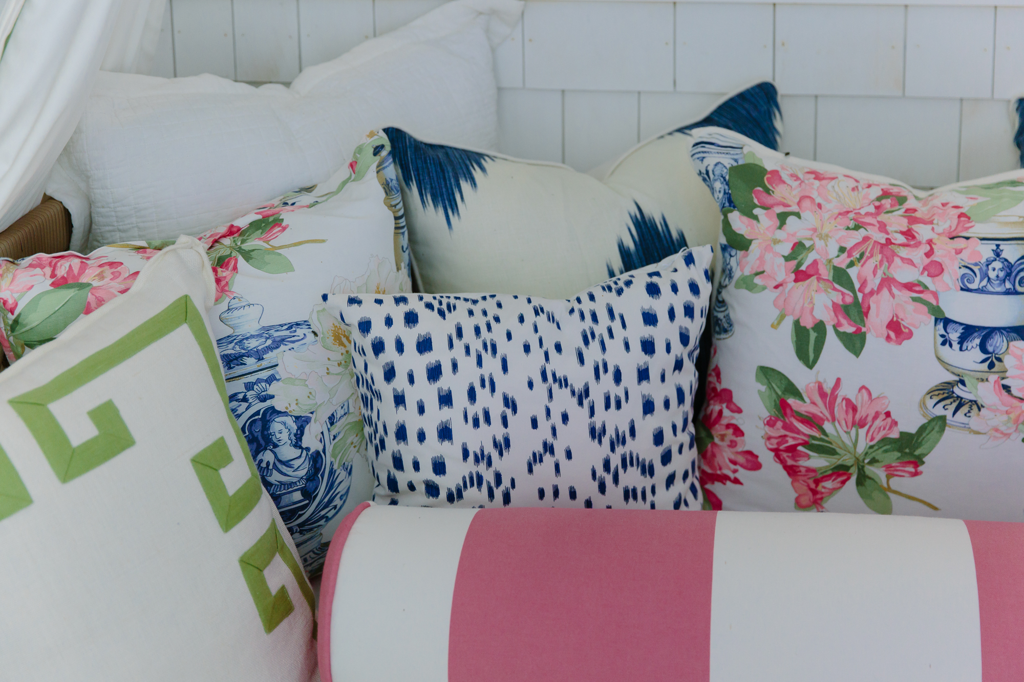 blue pink and green patterned pillows