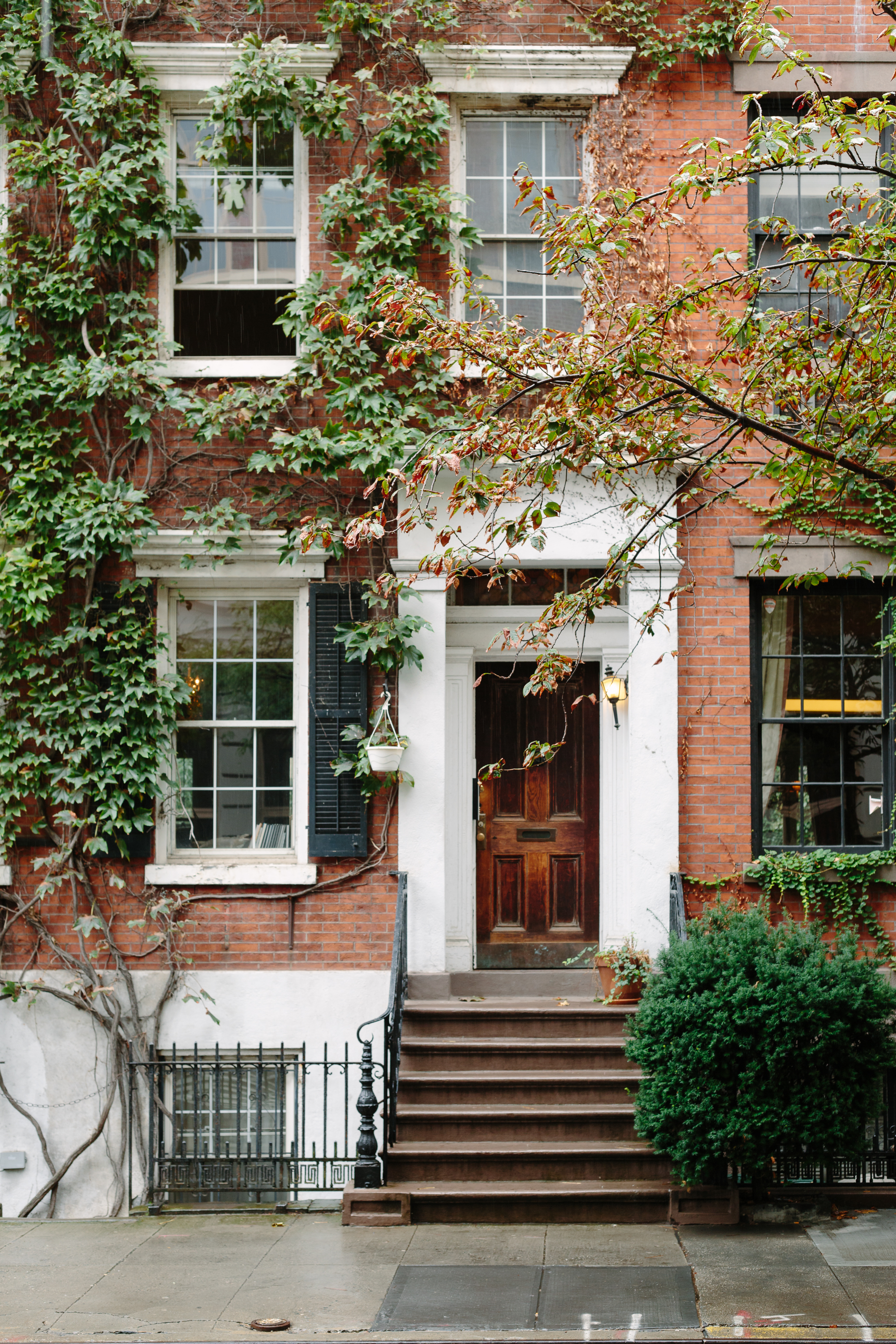 Ivy covered house on Grove Street in the West Village NYC - West Village NYC featured by top NYC blogger, York Avenue