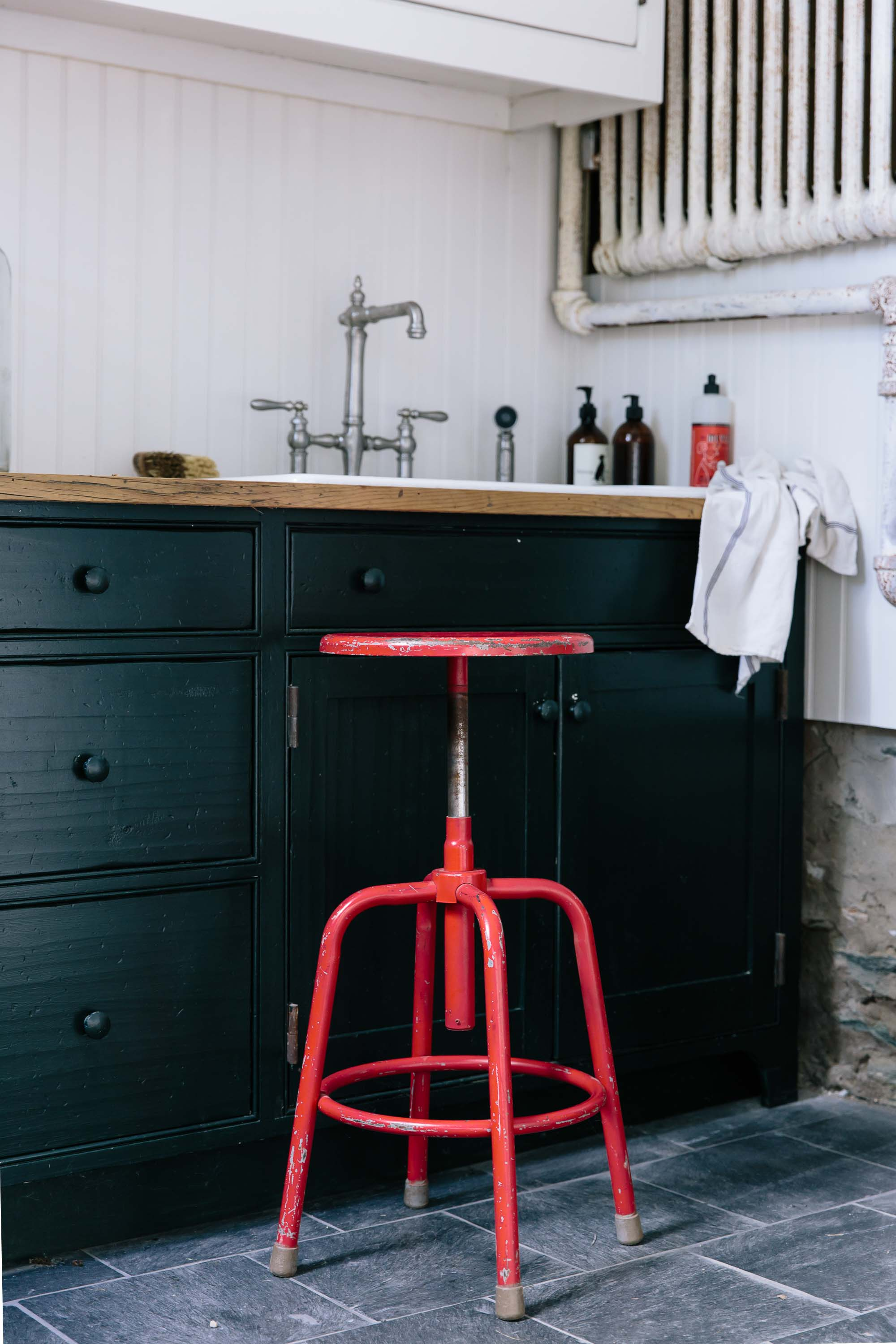 Red stool in the mudroom at The Inn at Kenmore Hall
