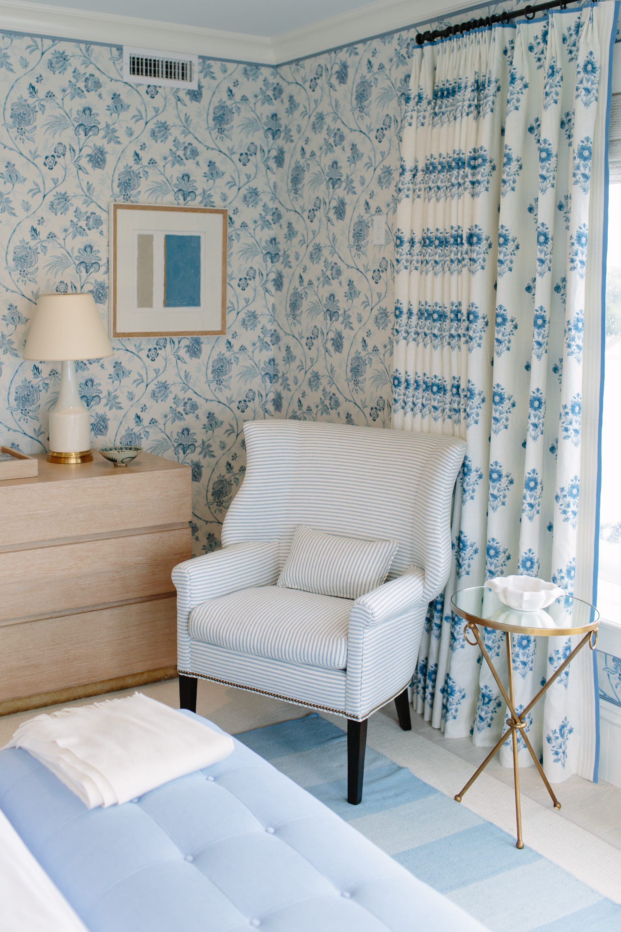 Corner of bedroom in Coastal Living Showhouse 2017 using Schumacher fabrics