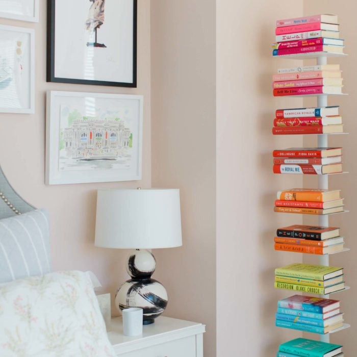 color coded bookshelves in a studio apartment